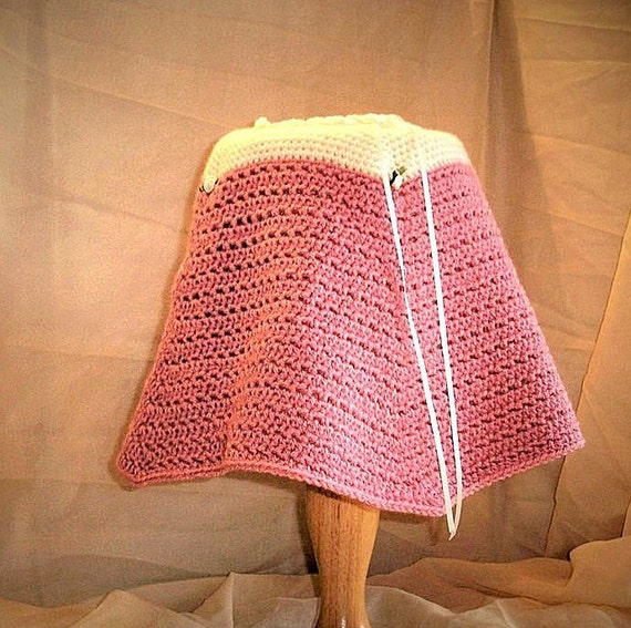 Baby Girl Warm, Cosy, Poncho crochete in soft cream and dusky pink yarn.  Ribbon Tie neck & Rose bud detai. Age 3 - 9 months