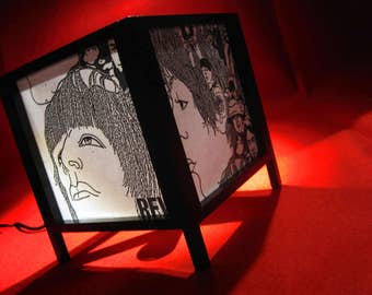 Handmade lamp in natural wood and japanese paper. The Beatles.