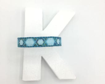 Shades of blue and leather woven bracelet