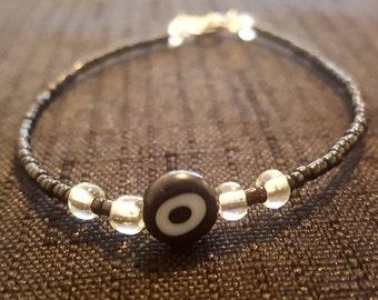 """Black and White """"Ojo"""" Beaded Bracelet"""