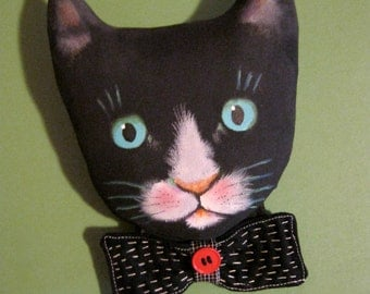 cat art doll head with bow tie , sandy mastroni, detailed stitching,  whimsical wall art ,shelf art,