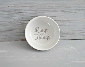 Rings & Things in glitter silver vinyl, porcelain trinket dish. Perfect for holding your rings  other shiny things by the sink. 3.25""