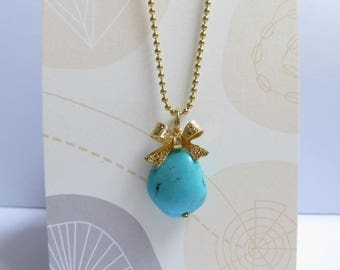 Turquoise Blue Howlite Pendant Gold Bow Necklace