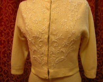 "1960's, 32"" bust, cream colored cardigan sweater with sequins"