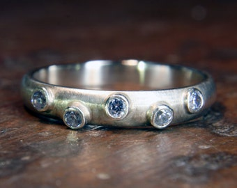 Recycled sterling silver & moissanite 3mm wide planished eternity or wedding ring. Hand made to order in the UK.