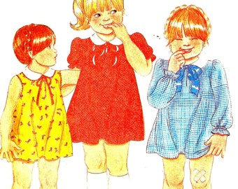 Vintage 1970s Girls Dress Sewing Pattern McCalls 6904 Flared, Peter Pan Collar, Long and short Sleeves Toddler Child Size 1 Cut Pieces
