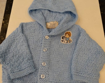 BABY HOODIE SWEATER,powder blue , with applique,5 buttons,hand knitted ,size 18 t0 24 months ,basket weave stitch.
