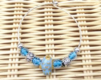 Fish Bangle Bracelet, Silver Charm Bracelet, Blue Glass Beads, Silver Filigree Beads, Gift for Her, Orange & Blue Ceramic Fish Bead