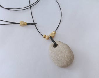 Beach pebble necklace. Natural holey stone pendant with long black cord. Talisman hag stone. Metaphysical rock healing amulet.