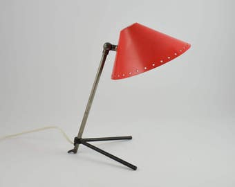 Pinocchio red wall or table lamp designed in 1956 by H.Th.A. Busquet.