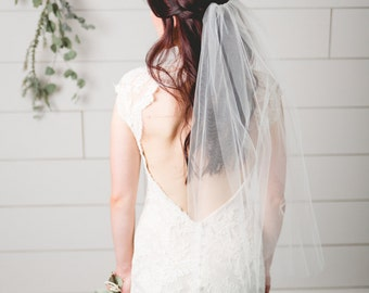 Bridal tulle elbow length veil