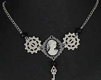 Classic Steampunk gears, keys and cameo necklace by Sylvan Creations.