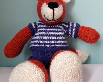 Hand knitted fox with stripped jumper and dungarees.