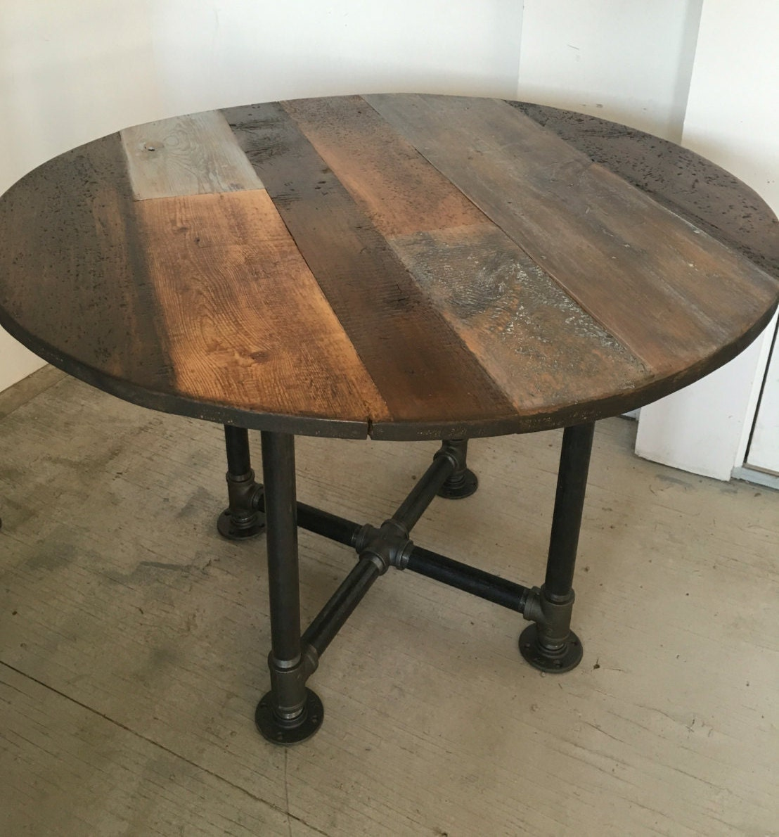 Round table dining tablepipe leg base reclaimed wood planks for Circle furniture dining tables
