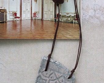 Light blue asymmetrical ceramic handmade pendant, necklace with imprint.