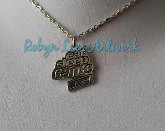 Silver Eat Sleep Game Word & Controller Charm Necklace on Silver Crossed Chain or Black Faux Suede Cord. Gamer, Costume, Gaming, Different