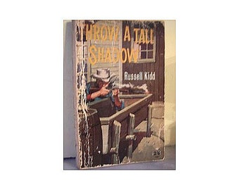 Vintage paperback 1960s Western book Throw a Tall Shadow Russell Kidd 1968 Wild west gunfights cowboys adventure pulp fiction 323