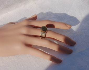 Large Heavy Silver ring with a Tourmaline Gem. Most impressive.