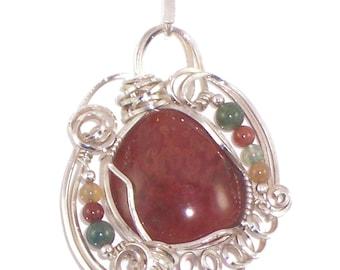 Handcrafted carnelian nugget pendant bezel set in sterling silver