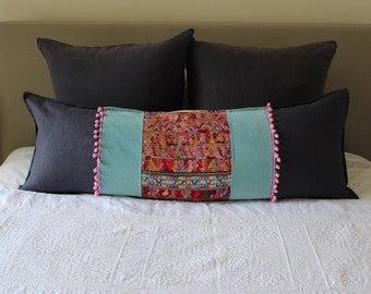 Long Cushion featuring Vintage Guatemalan Embroidery with Copper Leather, Turquoise Cotton Velvet, Eco-Friendly linen and Pink Pom-poms