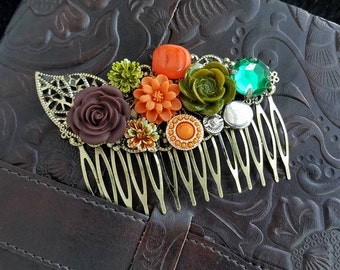 Autumn inspired handmade hair comb with many features – big brown Rose complimented by gems, orange and green flowers with a little sunshine