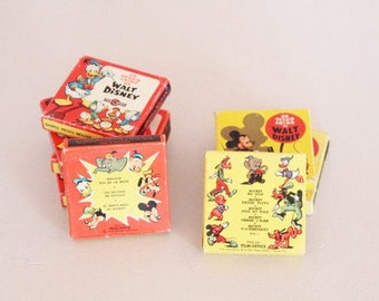 Walt Disney colored movies, 8 mm movies, colores film of Mickey, disney movies 8 mm, 8 mm cartoon, movie spool, office movie super 8