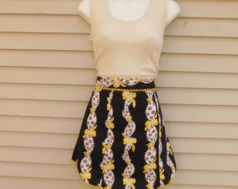50's Black And White Floral Half Apron With Yellow Bows And Ric Rac Trim