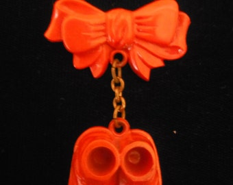 Adorable vintage red celluloid new baby pin