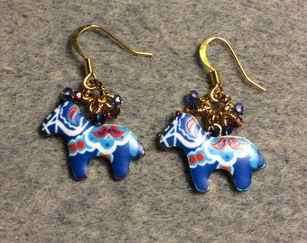 Blue and red enamel Scandinavian horse charm earrings adorned with tiny dangling blue and red Chinese crystal beads.