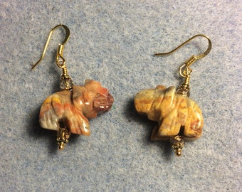 Yellow crazy agate gemstone elephant bead earrings adorned with gold Chinese crystal beads.