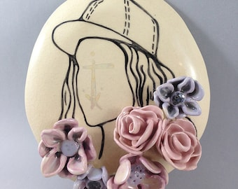 "ceramic illustration ""blossom"", drawing of a girl with shimmery mother of pearl luster and ceramic flowers"