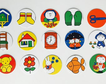 15 cardboard circles with Nijntje / Miffy and other prints made by Dick Bruna