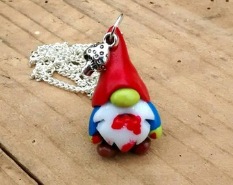 Tiny little 3cm Zombie Gnome pendant with toadstool charm.