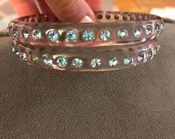 Clear lucite vintage bangles with blue rhinestones