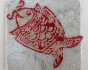 Stone coaster with smiling fish