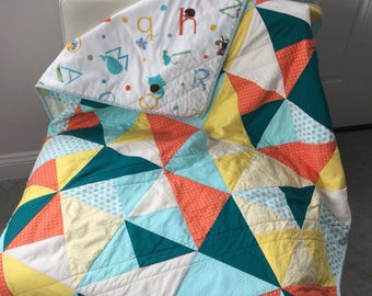 Modern baby quilt, vibrant teals, oranges and yellow triangles with alphabet minky