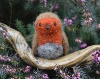 Robin on tree branch, bird sculpted by needle felting