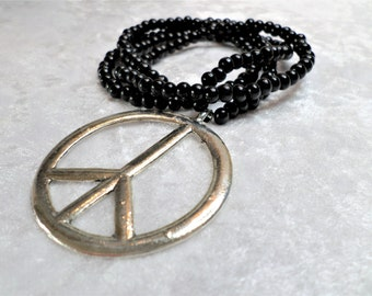 Pearl necklace made of ebony, black, peace pendant, handmade