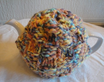 chunky knit tea cosy, orange-mix tea cozy, tea cozy wool-knit, knitted tea cosy, yellow knit tea cozy, basket-weave cosy, thick wool teacosy
