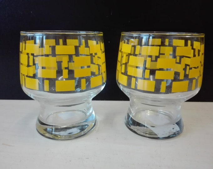 Set of two vintage yellow glasses
