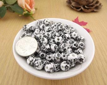 50 x Black floral ceramic beads 10mm