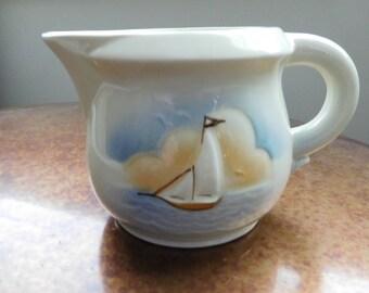 Vintage stoneware creamer with nautical scene.  Sail boat.  No marks.  Ocean.  Cottage.  Seaside.