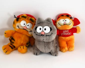 Three vintage Garfield plush stuffed animals - Nermal, gray cat, suction cup, car, 1970s, 1980s