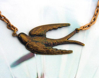 Womens Golden Swallow Necklace with Gold colored Chain.