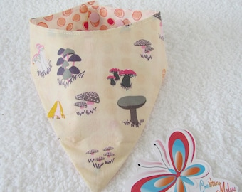 bandana bib with mushroom on a beige background