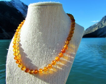 vintage round baltic amber bead necklace with silver clasp.