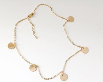 Necklace with disc pendants
