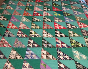 Bold vintage flying geese quilt top with some feed sack fabric newly quilted