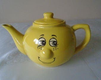 bright yellow Trade winds wind face tea pot