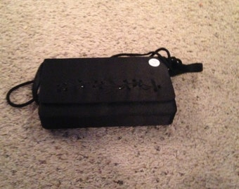 Vintage black evening bag with shoulder handle that can be tucked in